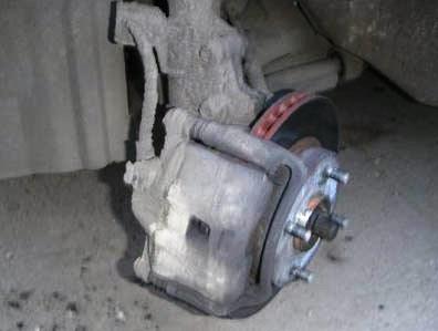 Суппорт с тормозным диском Nissan Almera Classic